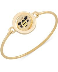 Carolee Gold-Tone Word Play Bee Spinning Charm Bangle Bracelet - Lyst