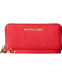 MICHAEL Michael Kors Jet Set Travel Large Coin Mlt Funt Phone Case red - Lyst