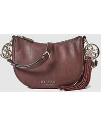 d8cad39199 Guess - Burgundy Crossbody Bag With Matching Tassel - Lyst