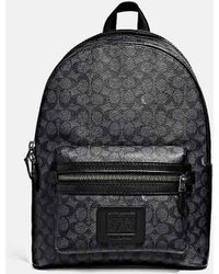b29581517d COACH - Academy Backpack In Signature Coated Canvas - Lyst