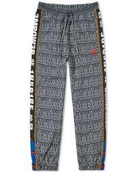 9a2b7c48de3cd adidas Originals X Pharrell Williams Hu Hiking Joggers In Red Cy7870 ...