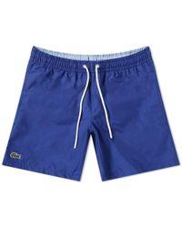 e4c6652e5c1d Lyst - Men s Lacoste Beachwear Online Sale