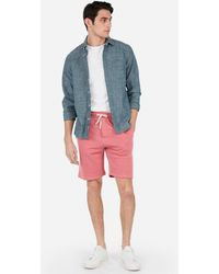 e7becf00f5 Express Classic Fit 10 Inch Garment Dyed Flat Front Stretch Shorts in  Metallic for Men - Lyst