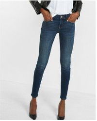 Express - Mid Rise Stretch+ Performance Skinny Jeans, Women's Size:16 Short - Lyst