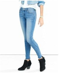 Express | Mid Rise Faded Medium Wash Jean Legging | Lyst