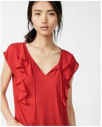 Express - Tie Neck Ruffle Front Cap Sleeve Blouse - Lyst