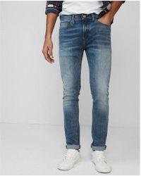Express - Slim Light Wash Tough Stretch+ Jeans, Men's Size:w36 L34 - Lyst
