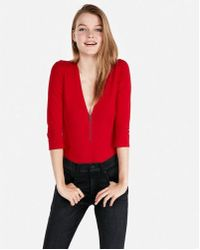 Express - One Eleven Deep V Front Zip Thong Bodysuit - Lyst