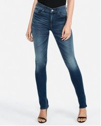 Express - Mid Rise Medium Wash Extreme Stretch+ Skyscraper Jeans, Women's Size:00 Short - Lyst