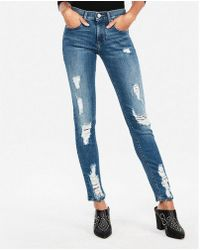 Express - Mid Rise Ripped Stretch Super Skinny Jeans, Women's Size:00 Short - Lyst