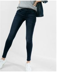 Express - Mid Rise Stretch+ Supersoft Jean Leggings, Women's Size:00 Short - Lyst