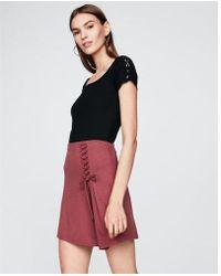 Express - Asymmetrical Lace-up Mini Skirt - Lyst