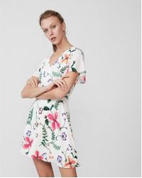 Express - Petite Floral Surplice Flutter Sleeve Fit And Flare Dress - Lyst