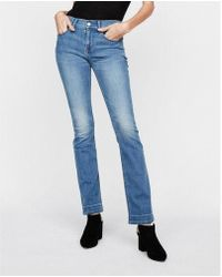 Express - Mid Rise Stretch Barely Boot Jeans, Women's Size:00 Short - Lyst