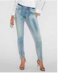 Express - Mid Rise Faded Stretch+ Jean Leggings, Women's Size:16 Short - Lyst