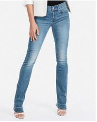 Express - Petite Mid Rise Stretch Barely Boot Jeans, Women's Size:00 Petite - Lyst