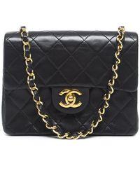 Chanel Pre-owned Black Lambskin Mini Flap Bag - Lyst