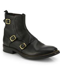Alexander McQueen Three-Buckle Leather Ankle Boots - Lyst