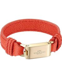 Coach Leather Horse And Carriage Id Bracelet red - Lyst