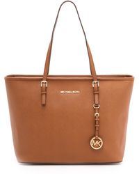 Michael by Michael Kors Jet Set Top Zip Tote Luggage - Lyst