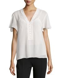 Marchesa Voyage - Flutter-sleeve Button-trimmed Blouse - Lyst
