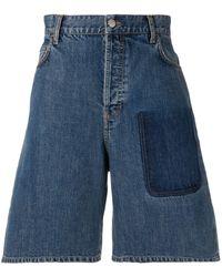 JW Anderson Shorts vaqueros con detalle de bolsillo