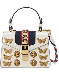 12996593c32e4f Gucci Mini Sylvie Leather Bag W/ Appliqués in White - Lyst