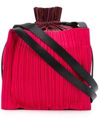 6c86b7b515f0 Shop Women s Pleats Please Issey Miyake Shoulder bags Online Sale