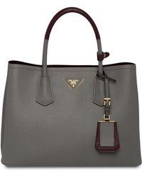 0321c9dd07 Prada Saffiano Drawstring Bag in Black - Lyst