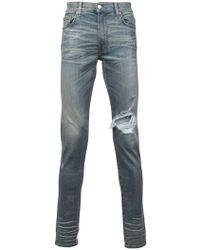 Amiri - Jeans skinny effetto vissuto - Lyst