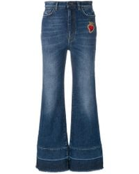 Dolce & Gabbana - Flared Jeans With Sacred Heart Appliqué - Lyst