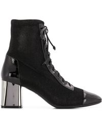 6734ff67ac5 Casadei Triangle Ankle Boots in Black - Lyst