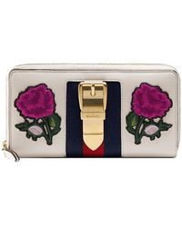 74ed1e7c89d864 Gucci - Multicoloured Sylvie Embroidered Leather Zip Around Wallet - Lyst