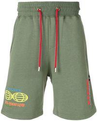 Gcds - Pantalones cortos de chándal estampados - Lyst
