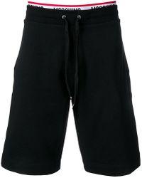 Moschino - Pantalones cortos con logo - Lyst