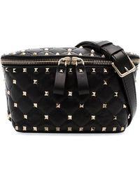 732183d7d91 Valentino Garavani Rockstud Belt Bag in Black - Lyst