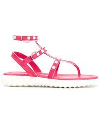ac32736ed4f896 Lyst - Valentino Garavani Rockstud Gladiator Sandals in Pink