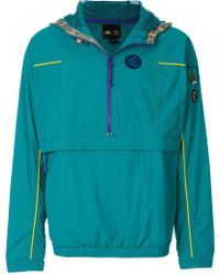 e1f4a54da6 adidas Originals - Pharrell Williams Hu Hiking Packable Windbreaker Jacket  - Lyst