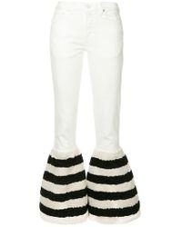 Tu Es Mon Tresor - Striped Faux Fur Hem Flared Jeans - Lyst