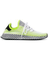 Adidas originali deerupt correre le scarpe da ginnastica in verde per gli uomini lyst