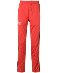 5e32c4c073c497 Lyst - adidas Originals Jogginghose in Orange mit 3-Streifendesign ...