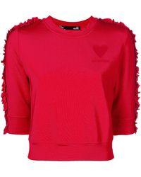 Love Moschino - Cropped Ruffle Trim Sweatshirt - Lyst