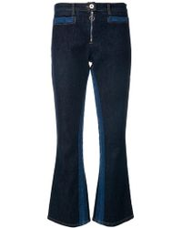 Courreges - Contrast Flared Jeans - Lyst