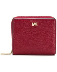 429e7e6362eb7d ... official store michael michael kors small zip around wallet lyst 76fed  4e2a6