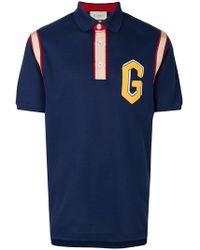 bdc523b4 Lyst - Gucci Logo Stripe Polo Shirt in Black for Men