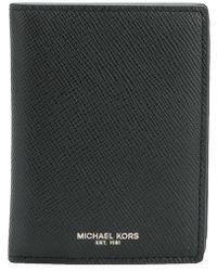 Michael Kors - Portamonete con logo goffrato - Lyst