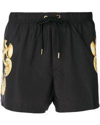 Versace - Shorts con motivo barroco - Lyst