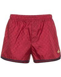 Gucci - Shorts de baño con motivo GG monogram - Lyst