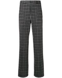 Givenchy - Checked Wool Blend Trousers - Lyst
