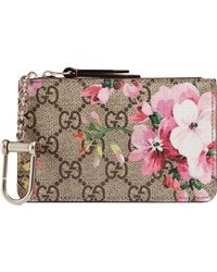 5dc193a5df5ea2 Gucci Gg Blooms Coated Canvas And Leather Clutch in Gray - Lyst